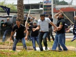 حزب الله يقتل متظاهر أمام السفارة الإيرانية في بيروت