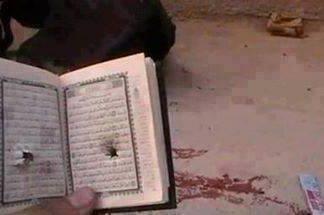 رصاص الانقلاب يخترق كتاب الله يقتل حامله