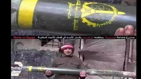 مواطن سوري يحمل صاروخ مصري سقط على حي صاخور بحلب و لم ينفجر